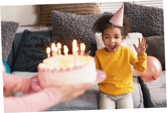 Birthday cake being presented to a child